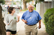 The Rev. Dr. Carlos Hernandez, director of LCMS Church and Community Engagement, walks with Abigail Konig of the 2014 Youth Corps pilot project during a Gospel Seeds training session near Shepherd of the City Lutheran Church on Tuesday, August 12, 2014, in Philadelphia, Pa. LCMS Communications/Erik M. Lunsford