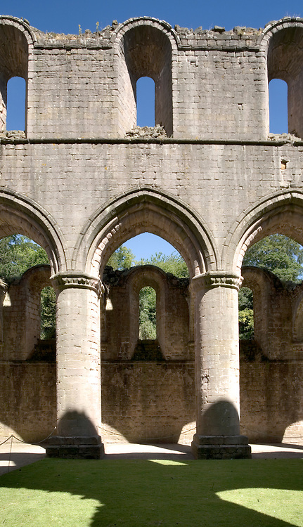 Yorkshire, Fountains Abbey ruins: detail of one bay in the nave, with clerestory windows above.