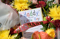 © London News Pictures. 26/05/2013. Woolwich, UK. Flowers left by Rebecca Rigby, wife of Drummer Lee Rigby at the scene where he was murdered by two men in Woolwich town centre in what is being described as a terrorist attack. Photo credit: Ben Cawthra/LNP