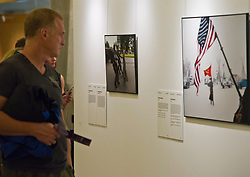 Pictured: <br /> Scottish Parliament Deputy Presiding Officer Christine Grahame, Sanne Schim van der Loeff of World Press Photo, and photographer Tom Stoddart were on hand as the World Press Photo exhibition was launched at the Scottish Parliament today.<br /> Ger Harley | EEm 3 August  2017