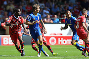 AFC Wimbledon defender Paul Robinson (6), Walsall FC midfielder Isaiah Osbourne (14) during the EFL Sky Bet League 1 match between Walsall and AFC Wimbledon at the Banks's Stadium, Walsall, England on 6 August 2016. Photo by Stuart Butcher.