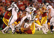 25 OCTOBER 2008: Texas A&M running back Cyrus Gray (32) is brought down by Iowa State defensive end Kurtis Taylor (47) and Iowa State defensive back Leonard Johnson (23) in the first half of an NCAA college football game between Iowa State and Texas A&M, at Jack Trice Stadium in Ames, Iowa on Saturday Oct. 25, 2008. Texas A&M beat Iowa State 49-35.