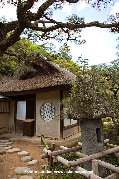 Teahouse at Ritsurin - a landscape garden in Takamatsu  built by the local feudal lords during the Edo Period. Considered one of the finest gardens in Japan,  Ritsurin features many ponds, hills and pavilions set in front of wooded Mt. Shiun which serves as a background and example of borrowed scenery and Japanese gardening design.