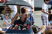 BAR HARBOR, MAINE, July 4, 2014. A member of the Anah Shriners drives a mini-car in the Independence Day Parade
