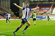 Wigan Athletic midfielder Nick Powell (25) thinks he's scored but the goal is ruled out for offside during the EFL Sky Bet League 1 match between Wigan Athletic and Plymouth Argyle at the DW Stadium, Wigan, England on 26 September 2017. Photo by Craig Galloway.