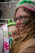 March 17, 2015 - New York, NY. Mother, child sport  matching shamrocks during New York City's annual St. Patrick's Day parade on 5th  Avenue. 04/17/2013 Photograph by Kevin R. Convey/NYCity Photo Wire