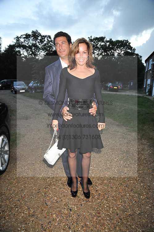 TARA PALMER TOMKINSON and EDUARDO TEODORANI-FABBRI at a Summer party hosted by Lady Annabel Goldsmith at her home Ormeley Lodge, Ham, Surrey on 14th July 2009.
