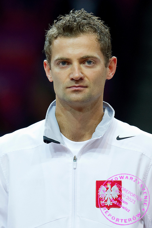 Mariusz Fyrstenberg of Poland while national anthem before the BNP Paribas Davis Cup 2013 between Poland and Australia at Torwar Hall in Warsaw on September 13, 2013.<br /> <br /> Poland, Warsaw, September 13, 2013<br /> <br /> Picture also available in RAW (NEF) or TIFF format on special request.<br /> <br /> For editorial use only. Any commercial or promotional use requires permission.<br /> <br /> Photo by &copy; Adam Nurkiewicz / Mediasport