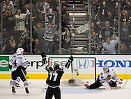 The Kings' Jeff Carter celebrates' Tyler Toffoli's second period goal on Blackhawks goaltender Corey Crawford during the Kings' 4-3 victory over the Chicago Blackhawks during Game 3 of the Western Conference Final of the 2014 NHL Stanley Cup Playoffs at Staples Center Saturday.