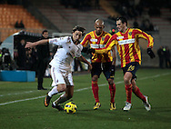 Lecce (LE), 16-01-2011 ITALY - Italian Soccer Championship Day 20 -  Lecce - Milan..Pictured: Ibrahimovic (M) Fabiano (L)..Photo by Giovanni Marino/OTNPhotos . Obligatory Credit