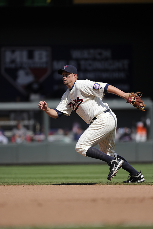 MINNEAPOLIS - APRIL 24:  Michael Cuddyer #5 of the Minnesota Twins fields against the Cleveland Indians on April 24, 2011 at Target Field in Minneapolis, Minnesota.  The Twins defeated the Indians 4-3.  (Photo by Ron Vesely)  Subject:  Michael Cuddyer