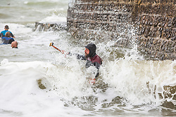 © Licensed to London News Pictures. 17/08/2019. Brighton, UK. Surfers take advantage of the strong waves to head out on to the sea in Brighton and Hove. Photo credit: Hugo Michiels/LNP