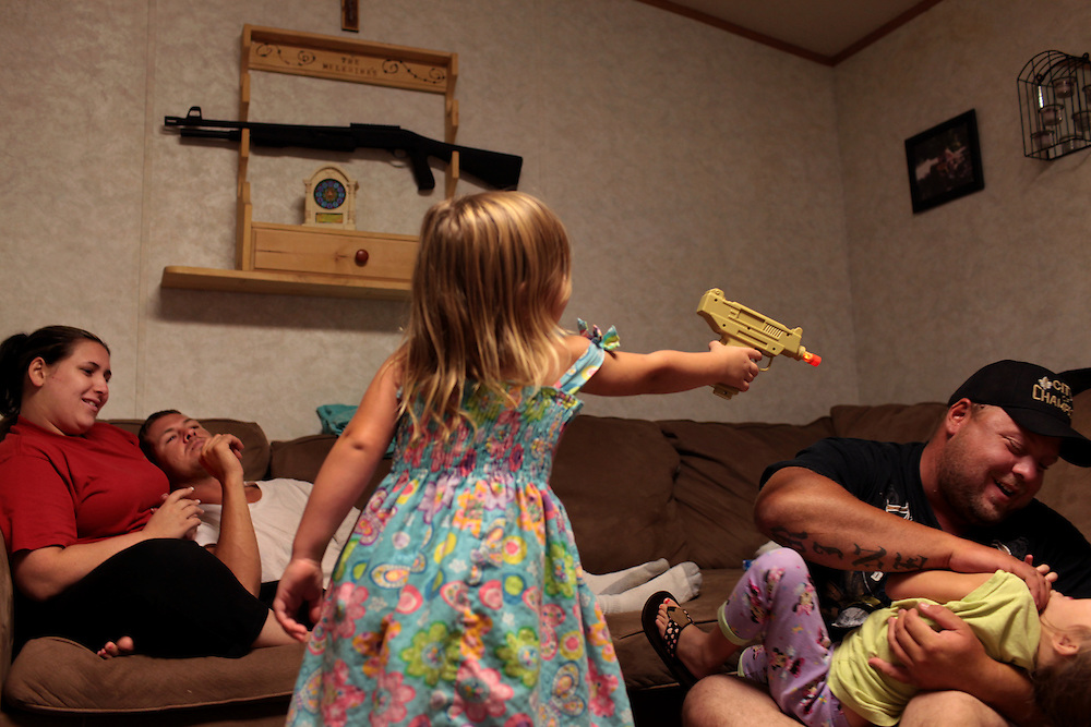 Eric Melerine and his brother Jason Melerine with his wife Nicole Melerine and children Hailey Melerine, 7, Gabrielle Melerine, green top, 4, Hannah Melerine, dress, 3, and Jason Melerine Jr., 2, at Eric's home in Violet, LA on July 18, 2010.