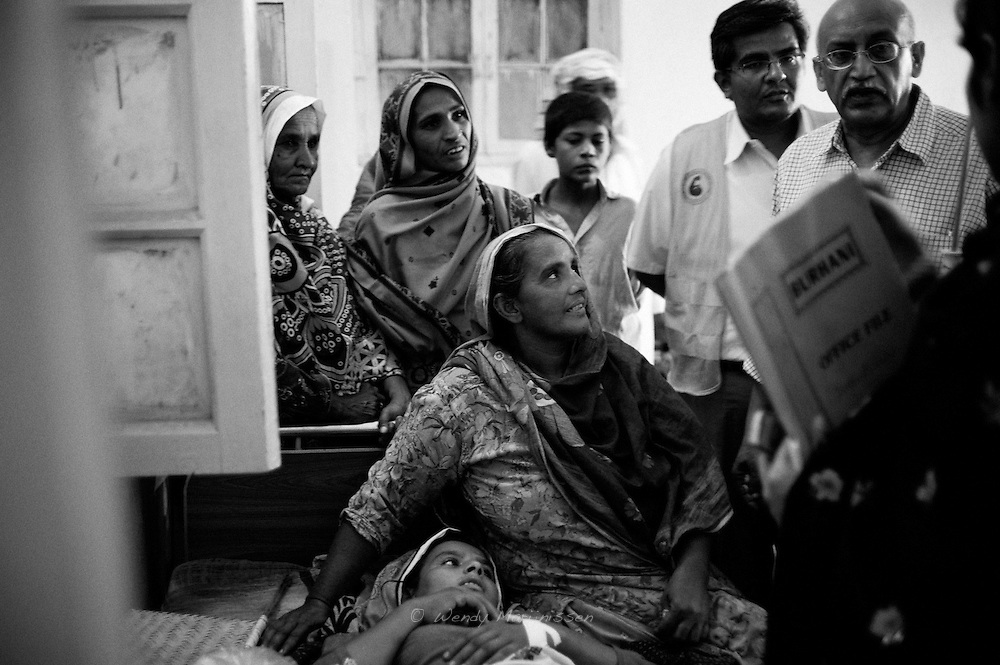 Nazia looks in admiration to Doctor Shershah Syed, a famous surgeon and women's rights activist who performed a caesarean section on Rabia and safely delivered her first baby. Thari Mirwah, Pakistan, 210