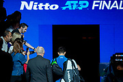 Novak Djokovic of Serbia exits the court and the tournament after being beaten by Roger Federer of Switzerland during the Nitto ATP Finals at the O2 Arena, London, United Kingdom on 14 November 2019.