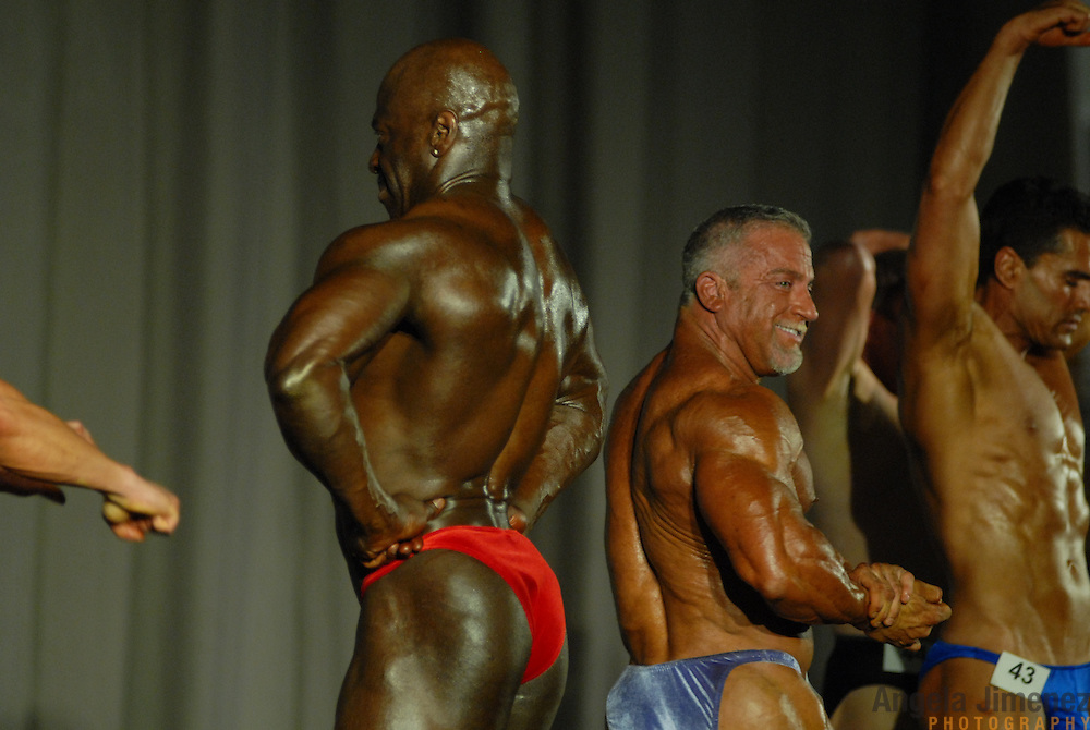 Competitors in the 40-49 year old age group heavyweight division of the Physique (bodybuilding) competition do a pose-off at McGaw Memorial Hall/Welsh-Ryan Arena at Northwestern University in Evanston, Illinois during the Gay Games VII competition on July 19, 2006. <br />  <br /> <br /> Over 12,000 gay and lesbian athletes from 60 countries are in Chicago competing in 30 sports during the Games from July 15 through 22, 2006. <br /> <br /> Over 50,000 athletes have competed in the quadrennial Games since they were founded by Dr. Tom Wadell, a 1968 Olympic decathlete, and a group of friends in San Francisco in 1982, with the goal of using athletics to promote community building and social change. <br /> <br /> The Gay Games resemble the Olympics in structure, but the spirit is one of inclusion, rather than exclusivity. There are no qualifying events or minimum or maximum requirements.<br /> <br /> The Games have been held in Vancouver (1990), New York (1994), Amsterdam (1998), and Sydney (2002).