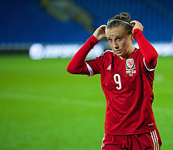 CARDIFF, WALES - Tuesday, August 21, 2014: Wales' Natasha Harding looks dejected after losing 4-0 to England during the FIFA Women's World Cup Canada 2015 Qualifying Group 6 match at the Cardiff City Stadium. (Pic by David Rawcliffe/Propaganda)