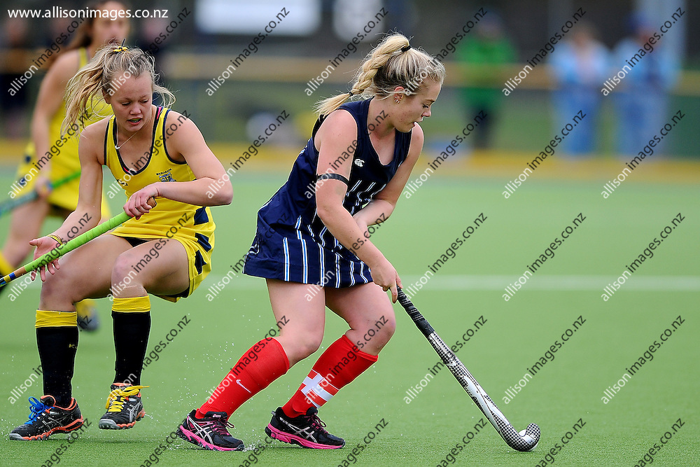 Mallory Cooper of St Hildas Collegiate looks to find a gap in defence, during the Federation Cup final between St Hildas Collegiate College and Wairarapa College, held at the McMillan Hockey Centre, Dunedin, New Zealand, 5 September 2014. Credit: Joe Allison / allisonimages.co.nz