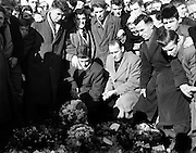 "Liam Whelan Funeral.19.02.1958..William Augustine Whelan (born 1 April 1935 in Dublin - 6 February 1958), also known as Billy Whelan or Liam Whelan, was an Irish footballer and one of the eight Manchester United players who were killed in the Munich air disaster. He was 22 years old when he died..Whelan was a devout Roman Catholic who came from a large family; his father John had died in 1943, when Whelan was eight years old. He was not a confident flyer and just before the aeroplane took off from Munich, he was heard to say: ""Well, if this is the time, then I'm ready."".Whelan began his career with Home Farm before joining Manchester United..He made 98 first-team appearances between August 1955 and February 1958, scoring 52 goals. He had previously played for Irish club Home Farm, and was capped four times for the Republic of Ireland national team, but unfortunately did not score..On 8 December 2006 the railway bridge on Faussagh Road/Dowth Avenue junction in Cabra, Dublin 7 close to Dalymount Park was renamed in his honour. The campaign to have the bridge renamed was initiated and organised by members of the Cabra, GAA club, Naomh Fionbarra (gaelic spelling) (St. Finbarr's) and sanctioned by Dublin City Council in early 2006. It is close to St. Attracta Road, the street in which he was born. The unveiling ceremony was performed by Whelan's Manchester United team mate at the time of the aircrash, Sir Bobby Charlton..On 4 February 2008, the Irish national postal body An Post issued a 55c postage stamp for the 50th anniversary of the Munich Air Disaster showing a photo of Liam Whelan.."
