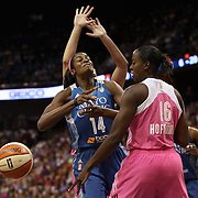 Devereaux Peters, (left), Minnesota Lynx and Ebony Hoffman, Connecticut Sun, challenge for a rebound during the Connecticut Sun Vs Minnesota Lynx, WNBA regular season game at Mohegan Sun Arena, Uncasville, Connecticut, USA. 27th July 2014. Photo Tim Clayton