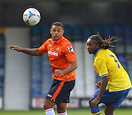 Picture by David Horn/Focus Images Ltd +44 7545 970036<br /> 03/08/2013<br /> Andre Gray of Luton Town and Tafari Moore of Arsenal XI during the Friendly match at Kenilworth Road, Luton.