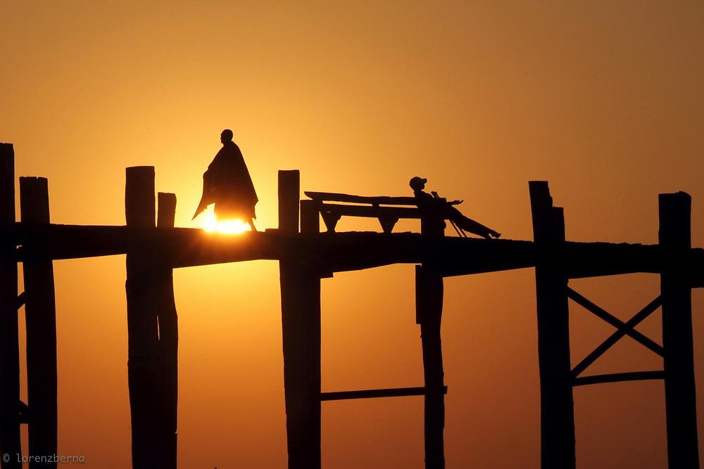 Sihilouettes at sunset on the U-Bain bridge in Myanmar.<br /> Photo by Lorenz Berna