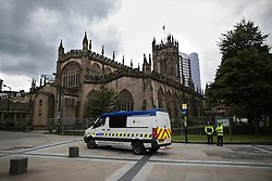 © Licensed to London News Pictures . 30/06/2016 . Manchester , UK . Police and security preparations outside Manchester Cathedral ahead of tomorrow's Somme100 commemorations , at which Manchester will see extended ceremonies to commemorate the 100th anniversary of the first day of the Battle of the Somme . Photo credit : Joel Goodman/LNP