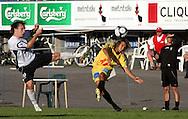18.07.2009, Tehtaankentt?, Valkeakoski, Finland..Veikkausliiga 2009 - Finnish League 2009.FC Haka Valkeakoski - Vaasan Palloseura.Jan Berg (VPS) v Mika M?kitalo (Haka).©Juha Tamminen...