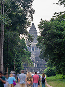 Tourists approach Angkor Wat Temple; Angkor Wat Archeological Park, Siem Reap, Cambodia.