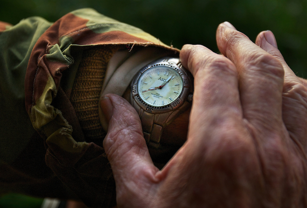 Lionel Swift double checks his watch, shooting started over half an hour ago but no sign of any ducks as yet. Opening of duck hunting season on the Murray Rive near Howlong. Pic By Craig Sillitoe CSZ/The Sunday Age. 19/3/2011 This photograph can be used for non commercial uses with attribution. Credit: Craig Sillitoe Photography / http://www.csillitoe.com<br /> <br /> It is protected under the Creative Commons Attribution-NonCommercial-ShareAlike 4.0 International License. To view a copy of this license, visit http://creativecommons.org/licenses/by-nc-sa/4.0/.