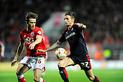 Bristol City defender Adam Matthews and Rotherham United forward Matt Derbyshire competing for the ball during the Sky Bet Championship match between Bristol City and Rotherham United at Ashton Gate, Bristol, England on 5 April 2016. Photo by Graham Hunt.