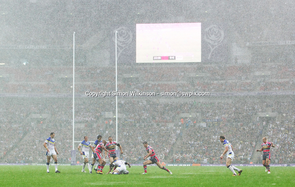 PICTURE BY VAUGHN RIDLEY/SWPIX.COM - Rugby League - Challenge Cup Final 2012 - Leeds Rhinos v Warrington Wolves - Wembley Stadium, London, England - 25/08/12 - Warrington and Leeds struggle in torrential downpour conditions.