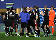 Carlisle United players celebrating with Keith Curle  after a hard fought win during the Capital One Cup match between Queens Park Rangers and Carlisle United at the Loftus Road Stadium, London, England on 25 August 2015. Photo by Matthew Redman.