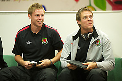 CARDIFF, WALES - Wednesday, September 1, 2010: Wales' Simon Church and Chris Gunter with an Apple iPad in a lounge at Cardiff Airport before the squad heads out to Podgorica ahead of the opening UEFA Euro 2012 Qualifying Group 4 match against Montenegro. (Pic by David Rawcliffe/Propaganda)