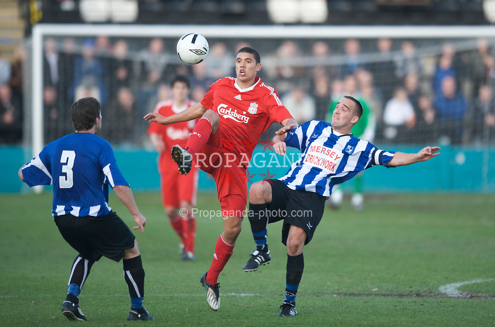 LIVERPOOL, ENGLAND - Monday, April 27, 2009: Liverpool's Victor Palsson and Waterloo Dock's captain Anthony Battle during the Liverpool Senior Cup Final at the Arriva Stadium. (Photo by David Rawcliffe/Propaganda)