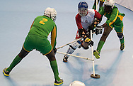 Match floor hockey between Poland (white) and South Africa (green) while during 2013 Special Olympics World Winter Games PyeongChang at Gangneung Sports Centre on February 1, 2013...South Korea, PyeongChang, February 1, 2013..Picture also available in RAW (NEF) or TIFF format on special request...For editorial use only. Any commercial or promotional use requires permission...Photo by © Adam Nurkiewicz / Mediasport