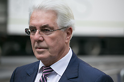 Max Clifford, British publicist, arrives at Southwark Crown Court, London, United Kingdom. Monday, 10th March 2014. Picture by Daniel Leal-Olivas / i-Images
