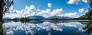 Reflections in wetland ponds along Tok Cutoff (often considered part of the Glenn Highway), north of Slana River bridge (19 miles north of Slana), in Alaska, USA. This image was stitched from multiple overlapping photos.
