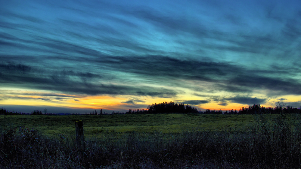 Pacific Northwest Winter cloudy sky sunset over field