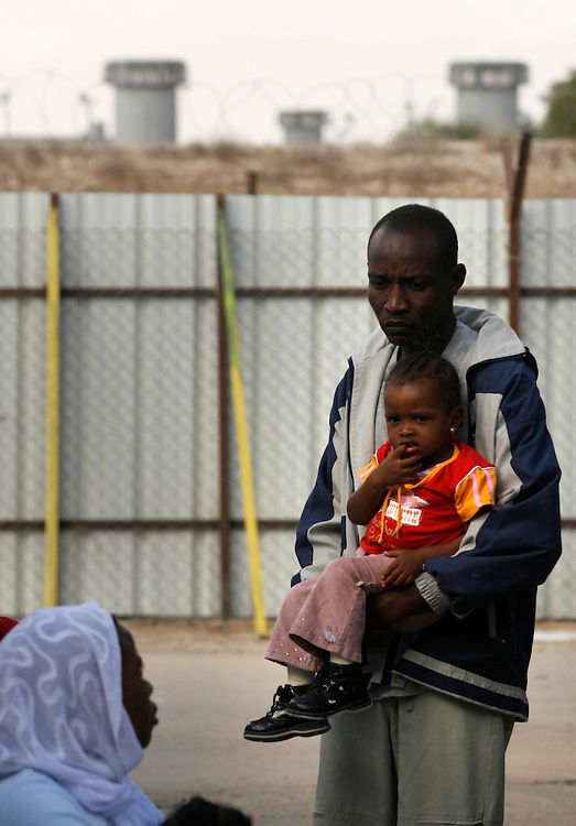 Refugees from the Sudan are seen in a detention camp in  Qeziot ,.. Israel, Monday November ,2,2007 .  Sudanese refugees some from the war- from Darfur region and others from southern Sudan, where civil strife has raged for more than two decades have walked across the Egypt-Israel border seeking political asylum and are now confined to an Israeli detention camp for few month after that Israel try to get them a place to stay and work...