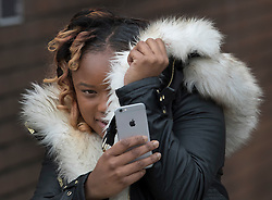 © Licensed to London News Pictures. 08/11/2016. London, UK. Shanique Pearson takes a phone photo of photographers  at Hammersmith Magistrates' Court. Ms Pearson is charged with various motoring offences after she was filmed confronting BBC broadcaster Jeremy Vine who was cycling in front of her car in August this year in Kensington.  Photo credit: Peter Macdiarmid/LNP