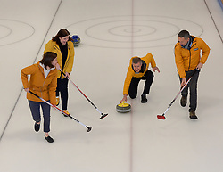 Pictured: Willie Rennie throws the stone, with sweepers campaign chairman Alex Cole Hamilton and candidate Jenny Marr (Berwickshire, Roxburgh and Selkirk) and Mental Health spokesperson Emma Walker.<br /> <br /> Scottish Liberal Democrat leader Willie Rennie took to the ice to try his hand at curling as he launched the party's Scottish manifesto in Edinburgh.<br /> <br /> © Dave Johnston / EEm