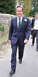 DAVID CAMERON at the wedding of Lohralee Stutz and the Hon.William Astor at St.Augustine's Church, East Hendred, Oxfordshire on 5th September 2009.