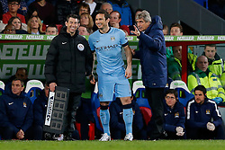 Manchester City Manager Manuel Pellegrini prepares to bring on Frank Lampard who shares a joke with the fourth official - Photo mandatory by-line: Rogan Thomson/JMP - 07966 386802 - 06/04/2015 - SPORT - FOOTBALL - London, England - Selhurst Park - Crystal Palace v Manchester City - Barclays Premier League.