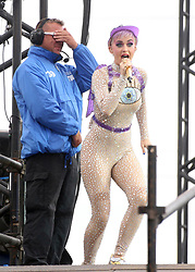 """© Licensed to London News Pictures. 24/06/2017. Security guard PAUL CARPENTER gets a dance as he watches KATY PERRY perform on the Pyramid Stage at Glastonbury Festival. Afterwards he said  """" I'll not forget that anytime soon """". Photo credit: Jason Bryant/LNP"""