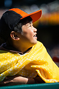 A young boy cheers for the Oakland Athletics and San Francisco Giants during a MLB exhibition game at Oakland Coliseum in Oakland, California, on March 25, 2018. (Stan Olszewski/Special to S.F. Examiner)