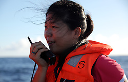 INDIAN OCEAN 28APR13 - Translator Lizzy Chen Ling-Chen of Taiwan communicates via a radio with the Taiwan-registered Chin Horng No 3 and the Panama-registered reefer vessel Tuna Queen.<br /> <br /> <br /> <br /> The Greenpeace ship Esperanza is on patrol documenting fishing activities in the Indian Ocean.<br /> <br /> <br /> <br /> jre/Photo by Jiri Rezac / Greenpeace