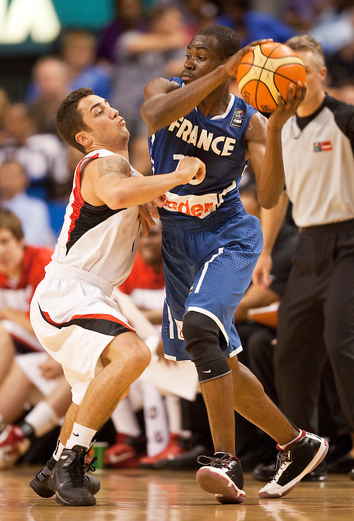 GJR517-20100813- Toronto, Ontario,Canada<br /> France's Yannick Bokolo tries to keep the ball from Canada's Tyler Kepkay during their team's second meeting in the 2010 Jack Donohue International Classic basketball tournament in Toronto, Canada August 13, 2010<br /> AFP PHOTO/Geoff Robins
