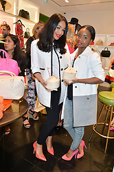 Left to right, SARAH-JANE CRAWFORD and A*M*E (Aminata Kabba) at a 'Tropical fete' at Kate Spade New York, 2 Symons Street, Sloane Square, London in celebration of the Chelsea Flower Show on 22nd May 2014.