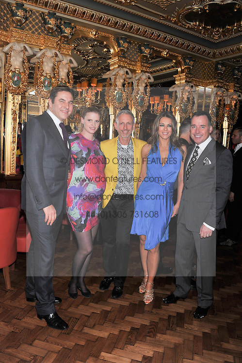Left to right, DAVID WALLIAMS, LARA STONE,  PATRICK COX, ELIZABETH HURLEY and DAVID FURNISH at the 50th birthday party for Patrick Cox held at the Café Royal Hotel, 68 Regent Street, London on 15th March 2013.